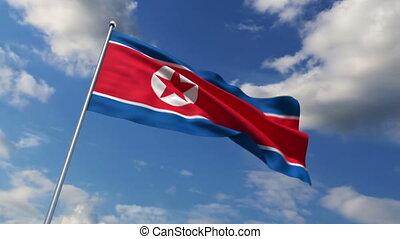 the North Korean flag waving against time-lapse clouds...