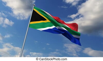 South African flag waving against time-lapse clouds...