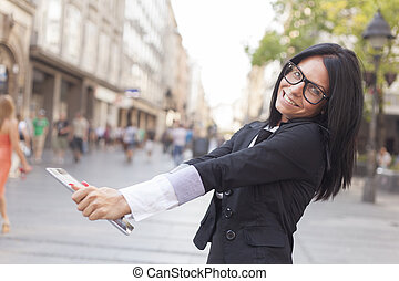 Beautiful Woman With Tablet Computer on street