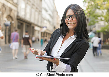 Woman With Tablet Computer On Street