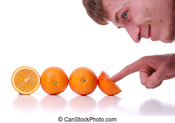 The man looking at oranges