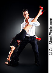 vigorous - Beautiful couple of professional artists dancing...
