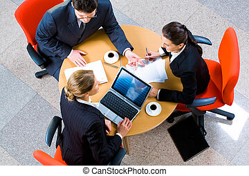 Teamwork - Image of people gathered together discussing a...
