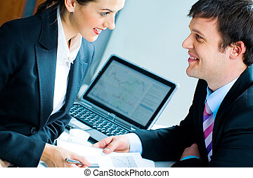 Business people - Portrait of woman and man looking at each...