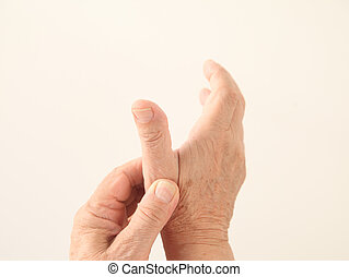 man has an aching thumb - a man holds his aching thumb
