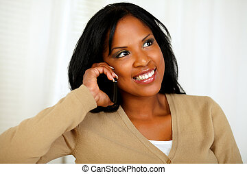 Stylish young woman conversing on cellphone - Portrait of a...