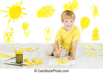 Happy child drawing with yellow color brush. Creativity concept.