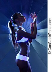 Beauty woman in dance with ultraviolet make-up