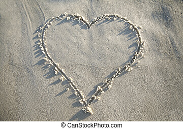 Heart Drawn in Sand - A heart is drawn in the white sand...