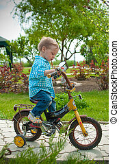 the boy on a bicycle - the boy in jeans and a blue shirt...