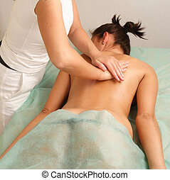 Deep regeneration - Woman getting a massage . Hands...
