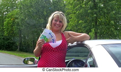 Gainings - Young woman with Euros standing by her car