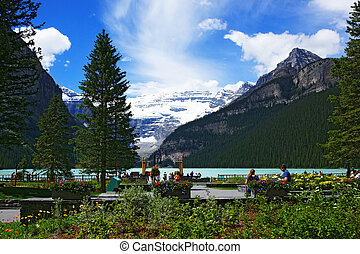 summer view of lake louise - people chilling out and dating...
