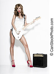 sexy fashion girl  with a guitar