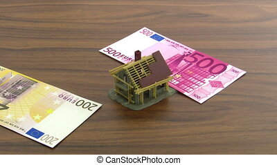 Homestead - Euro notes falling on a model house