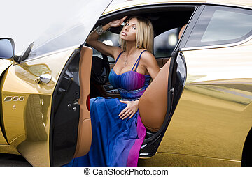 The sexual blonde in car salon