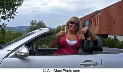 Lucky female driver - Young woman in her ragtop