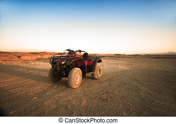 Red quad standing in Sinai mountains near Sharm el Sheikh -...