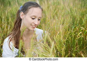 Beautiful woman smiles in field - Beautiful woman smiles in...