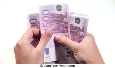 Men hand counts the euro