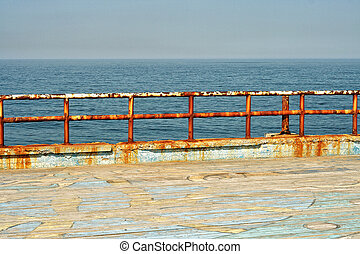 Grungy metal railings at the sea - Grungy metal railings...
