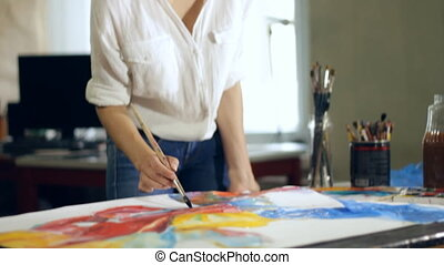Artist draws picture - Woman artist painting watercolor...