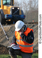 Surveyor working on construction site