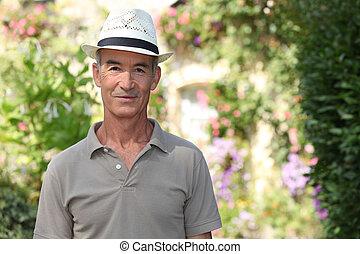 Elderly man with hat