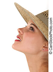 Profile of a woman in a straw hat