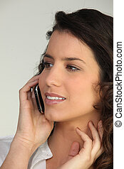 Young woman talking into a cellphone