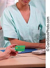 Nurse taking social security details