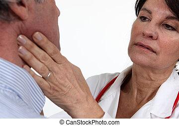 Doctor examining her patient