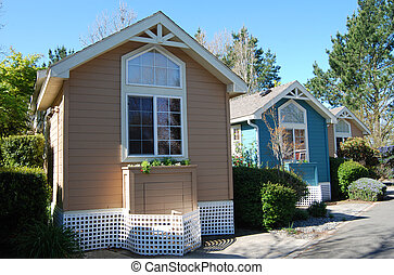 Small, tiny houses - Three very small houses next to each...
