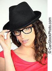 Woman wearing a black hat