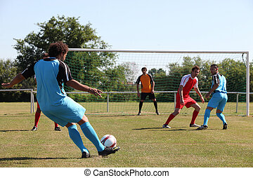 Footballer going for goal