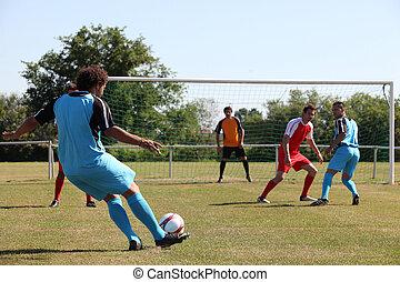 Footballer going for goal