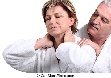 Man giving his wife a massage