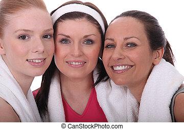 Three woman dressed in gym wear