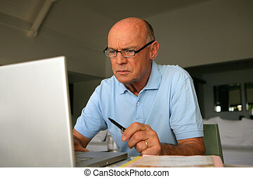 Elderly man concentrating on his work