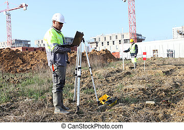 Surveyor on site with a laptop