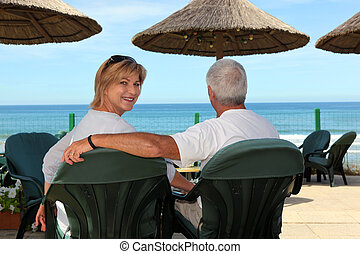 Couple at a seaside cafe