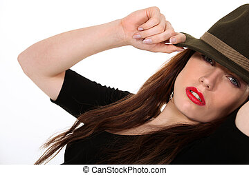 Mysterious woman wearing a Fedora hat