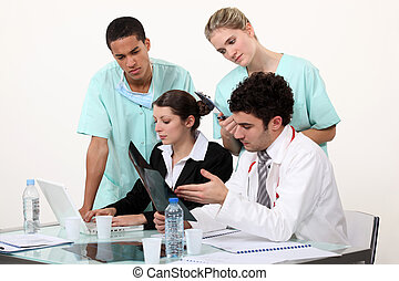 Medical staff gathered by desk
