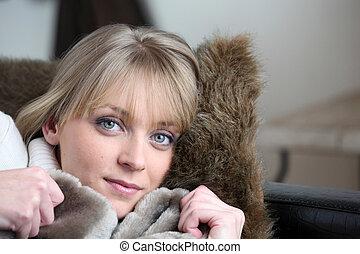 Woman snug on a sofa