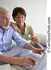 Senior couple shopping on-line