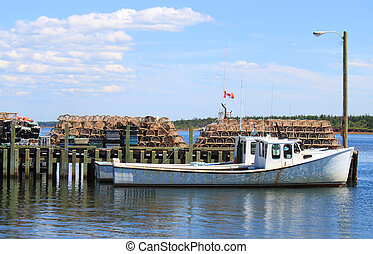 Maritime fishing boat - Fishing boat at pier with lobster...