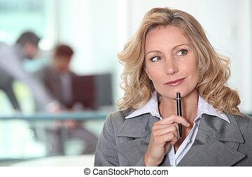 thoughtful blond woman