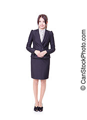 Confident business woman standing full length in black suit....