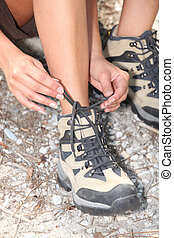 close-up of a woman doing up her shoelaces