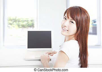 happy young woman using the laptop at home - happy young...